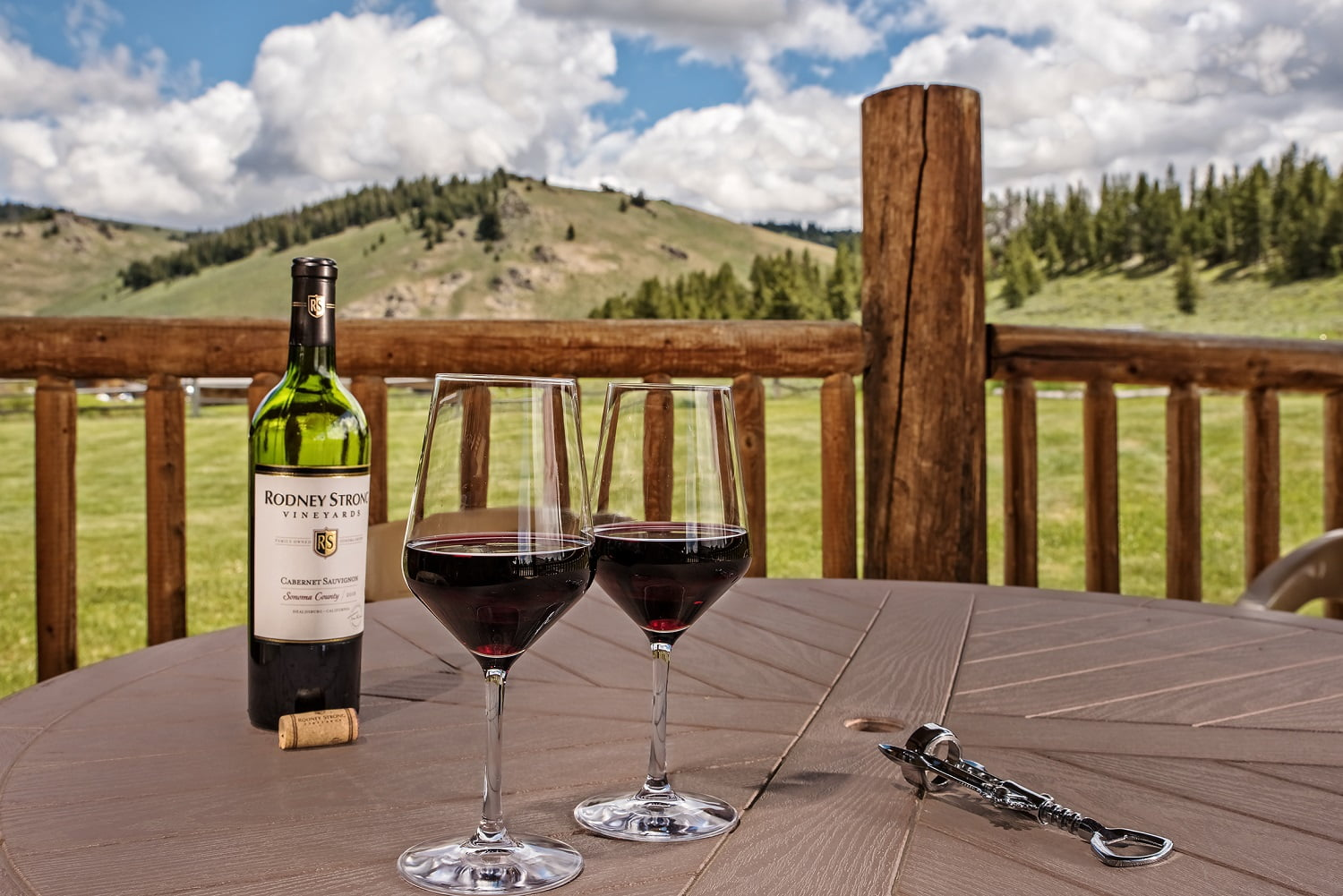 mountain view with wine glasses